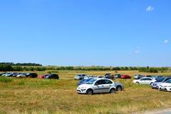 Cars waiting near Sinca Veche cave monastery Stock Photography