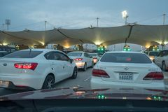 Cars waiting to cross Bahrain Saudi border Royalty Free Stock Photo