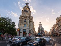 Cars waiting for traffic-light at the street cross Calle de Alcala and Gran Via at sunny evening in Madrid, Spain Royalty Free Stock Images