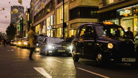 Cars waiting in Traffic, London, Oxford Circus stock video