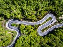 Cars on winding road trough the forest, Transfagarasan, Romania Stock Photo
