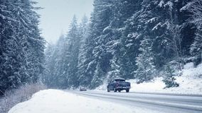 Cars On Winter Highway In Blizzard stock footage