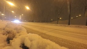 Cars on winter road during blizzard.  stock video