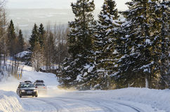 Cars on winter road Sweden Stock Image