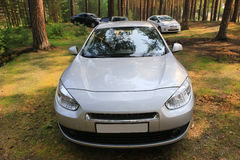 Cars in the wood on glade Stock Photography