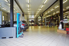 Cars in workshop of service station Royalty Free Stock Image
