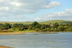 Carsington reservoir and wind generators. Royalty Free Stock Image