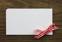 Cartão com bowknot Fotografia de Stock
