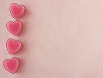 Cartão com quatro corações cor-de-rosa foto de stock