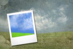 Cartão da foto no fundo da paisagem do grunge imagem de stock