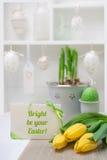 Cartão da Páscoa com fita e as tulipas amarelas Fotografia de Stock Royalty Free