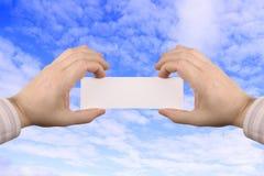 Cartão da terra arrendada da mão Imagem de Stock