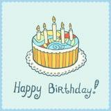 Cartão de aniversário com o bolo no fundo textured azul Imagens de Stock Royalty Free