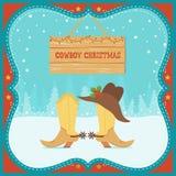 Cartão de Christmas do vaqueiro com botas ocidentais e chapéu no backg do inverno Imagens de Stock