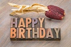 Cartão de cumprimentos do feliz aniversario no tipo de madeira Fotografia de Stock
