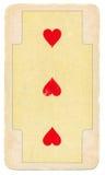 Cartão de jogo antigo com três corações vermelhos Fotografia de Stock