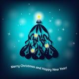 Cartão de Natal com a árvore de Natal no fundo borrado Fotografia de Stock Royalty Free
