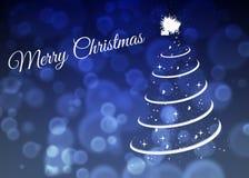 Cartão de Natal com a árvore de Natal no fundo azul foto de stock royalty free