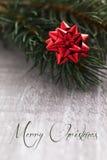 Cartão de Natal com Feliz Natal do texto Imagem de Stock
