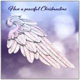 Cartão de Natal com fundo de Angel Wing e do borrão ilustração do vetor