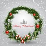 Cartão de Natal com a grinalda decorada com brinquedos Foto de Stock Royalty Free