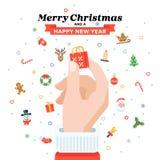 Cartão de Natal com a mão do ` s de Santa que guarda o saco de compras Projeto liso Imagens de Stock Royalty Free