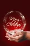 Cartão de Natal com mãos de uma criança no vermelho Imagens de Stock Royalty Free