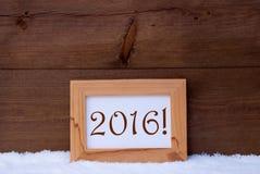 Cartão de Natal com moldura para retrato, texto 2016, neve Fotos de Stock Royalty Free