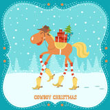 Cartão de Natal com o cavalo no chapéu e nas botas de vaqueiro Imagens de Stock