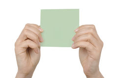 Cartão de papel nas mãos da mulher Imagem de Stock Royalty Free