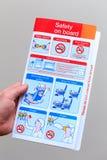 Cartão de segurança do avião de passageiros fotografia de stock royalty free