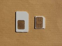 Cartão de SIM e de USIM usado nos telefones Imagem de Stock