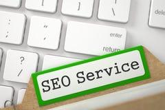 Cartão do arquivo com inscrição SEO Service ilustração 3D Fotos de Stock