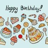 Cartão do feliz aniversario com os doces no fundo azul Fotos de Stock