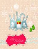 Cartão do Feliz Natal do vetor com frame dos coelhos Foto de Stock Royalty Free