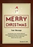 Cartão do Feliz Natal no vintage com símbolo do boneco de neve no fundo de madeira Fotografia de Stock Royalty Free