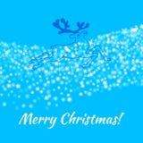 Cartão do Feliz Natal sobre o azul Fotografia de Stock