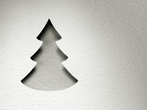 Cartão do monochrome do vintage do projeto do corte do papel da árvore de Natal Fotografia de Stock
