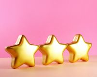 Cartão do Natal com estrelas do ouro Fotografia de Stock Royalty Free