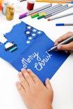 Cartão do Natal da escrita da criança Fotografia de Stock