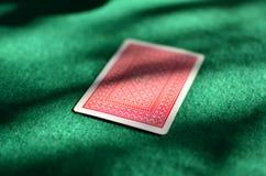 Cartão do pôquer sobre a tabela do pôquer Fotos de Stock