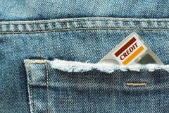 Cartão e calças de brim de crédito Fotos de Stock