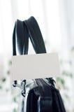 Cartão em um saco de couro Fotografia de Stock Royalty Free