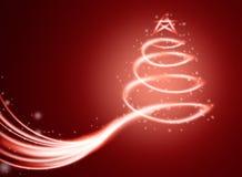 Cartão mágico do Natal com a árvore na luz e nos sparkles Fotos de Stock Royalty Free