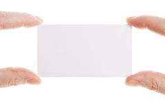 Cartão nas mãos fêmeas Fotos de Stock