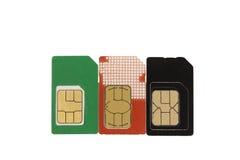 Cartão três de SIM Imagens de Stock