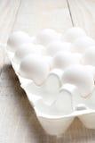 Cartón de huevos en blanco Imágenes de archivo libres de regalías