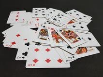 Cartões de jogo dispersados Fotografia de Stock