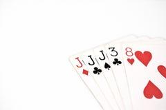 Cartões de jogo do grupo de símbolo das classificações da mão de pôquer no casino: três de um jaque do tipo no fundo branco, sumá Fotografia de Stock Royalty Free