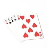 Cartões de jogo do grupo de símbolo das classificações da mão de pôquer no casino: três de um jaque do tipo no fundo branco, sumá Foto de Stock